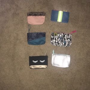 Six Ipsy small makeup bags